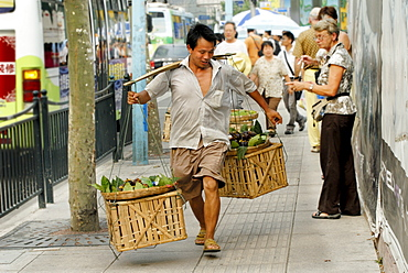 Chinese man with vegetables in baskets, Shanghai, China, Asia