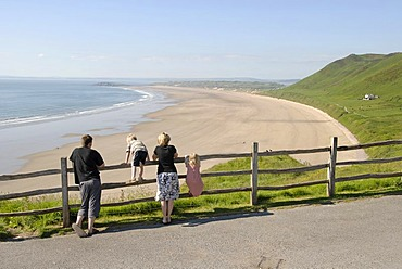 Family overlooking the beach and sea at a lookout point, Rhossili Beach, Gower Peninsula, Wales, Great Britain, Europe