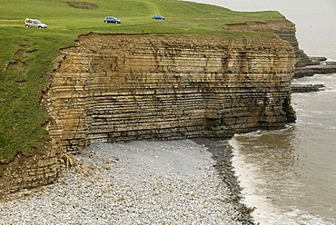 Cars parked on a cliff, steep coast, Nash Point, Glamorgan Heritage Coast, Wales, Great Britain, Europe