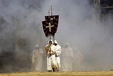 Monks in white cowls carries red flags with cross are befog, knight festival Kaltenberger Ritterspiele, Kaltenberg, Upper Bavaria, Germany