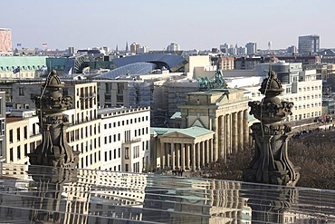 Brandenburg Gate and the roof of the DZ Bank viewed from the roof of the Reichstag or German Parliament Building in Berlin, Germany, Europe