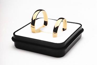 Wedding rings in a casket
