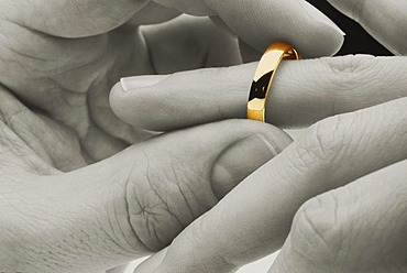 Putting a wedding ring on a finger