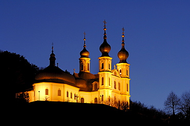 St. Maria Chapel illuminated at twilight, pilgrimage site in Wuerzburg, Bavaria, Germany