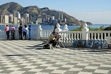 Street painter on a viewing platform, balcony of the Mediterranean, Benidorm, Costa Blanca, Spain