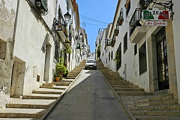 Car parking in a steep lane in the old part of town, Altea, Costa Blanca, Spain