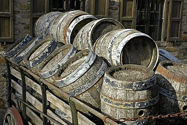 Old beer kegs on a cart in front of the brewery, Westphalian Open-Air Museum Hagen, Road of Industry Culture, North Rhine-Westphalia, Germany