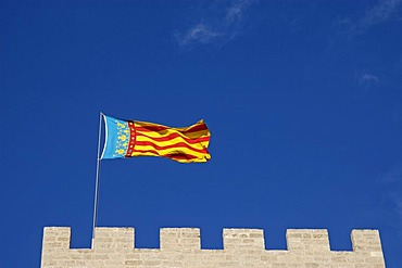 Valencian flag on the city gate, Torres de Serranos, Valencia, Spain