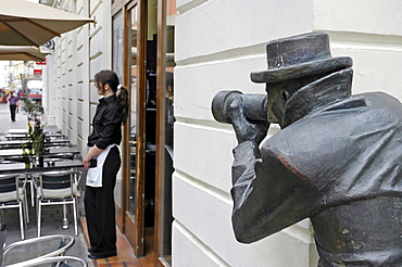 Paparazzi, bronze figure, and waitress, Bratislava, Slovakia