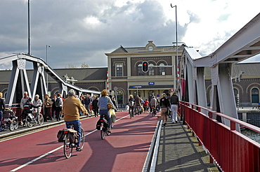 Cyclists on bridge near the main station, Middelburg Zeeland Holland the Netherlands