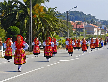 Traditionally dressed women, folk festival in honour of the three public saints Santos Populares, near by Porto, Portugal