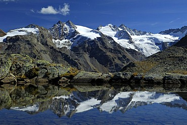 Mountain scenery reflected in glacial lake, Gran Paradiso National Park, Italy, Europe