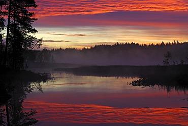Spectacular sunrise at a Swedish raised moss lake, Dalarna, Scandinavia, Sweden, Europe