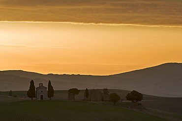 Typical Tuscan farm and small chapel at sunrise, Val d'Orcia, Tuscany, Italy, Europe