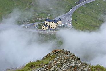 Alpine hotel Glocknerhaus between evening fog Carinthia Austria