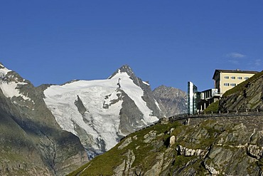 Early morning view of buildings on Franz Josefs Hohe in front of summit of Grossglockner Carinthia Austria