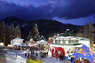 Bars and tents for the spectators around finish area first run ladies night slalom 12 29 2004 on Semmering in Lower Austria