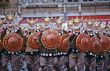 Singing vikings at procession in period dresses city of Brugge Belgium