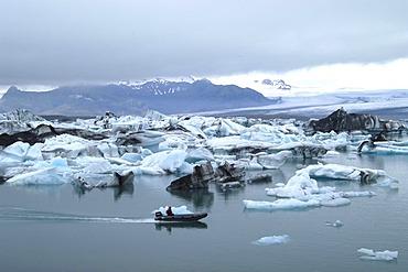 Rubber boat at the glacier lake Jokulsarlon Iceland