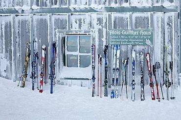 Ski lean on the wall of the Alois Gunther mountain hut on top of the mountain Stuhleck Styria Austria