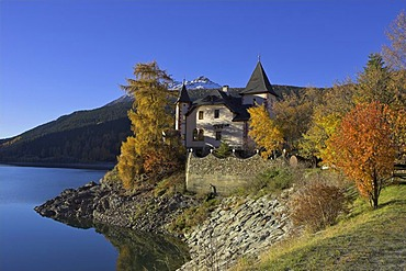 A villa built like a castle at the Reschen lake, Reschen pass, South Tyrol, Italy