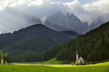 Church in St. Johann in Ranui and the Geisler mountain range, Villnosstal, South Tyrol, Italy
