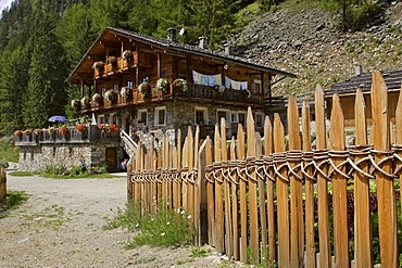 Traditional made wooden fence at the remote mountainfarm and inn called Kofler between the walls, South Tyrol, Italy