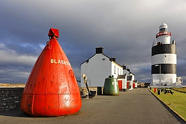 Buoy at the lighthouse of Hook¥s Head which is dating back to the 13.th century, County Wexford, Ireland