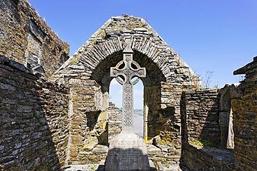 A celtic cross in the Timoleague Abbey, Cork, Ireland