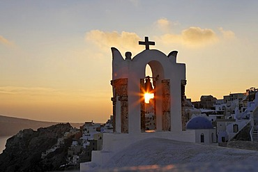 Bell tower of a chapel at sunset, Oia, Santorini, Greece