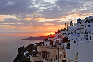 The village of Firostefani with the typical small alleys and the white painted houses at sunset, Firostefani, Santorini, Greece