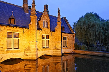 House built over the canal of the Minnewater, Brugge, Flanders, Belgium