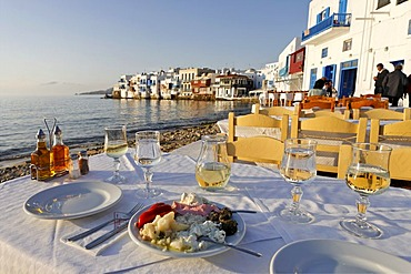 Greec appetizers and the view from a restaurant to Little Venice, Myconos, Greece