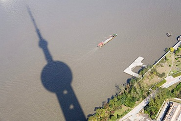 Shadow of the Oriental Pearl Tower falls on the Huangpu River, Pudong, Shanghai, China