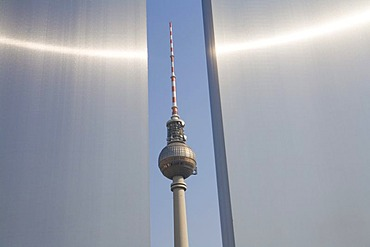TV tower, seen through a gap between two info boards of Marx Engels forum, Berlin, Germany, Europe