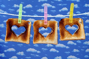 Toasts with cut out hearts on a clothesline