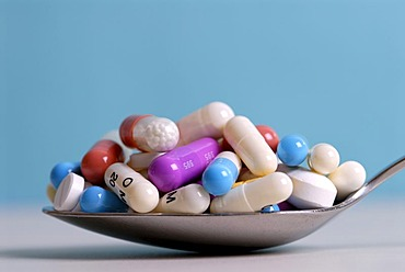 Tablets and pills on a spoon