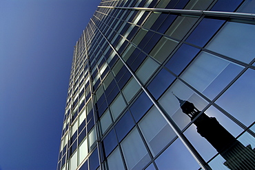 Reflection of St. Michaelis church in a glass front of an office building in Hamburg, Germany
