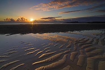Sunrise at Embleton Bay with Dunstaburgh Castle in the background, Craster, Northumberland, United Kingdom, Europe