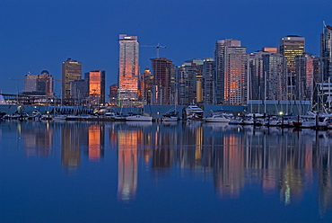 Sunset reflections, Coal Harbour, Downtown Vancouver, British Columbia, Canada