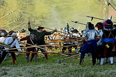Folk in battle, historical medieval city parade, in Canellis, LÂ¥assedio di Canelli, Canelli, Asti Province, Piemont, Italy
