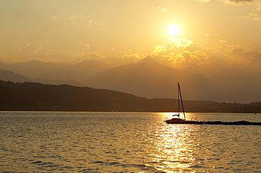 Sailing boats at Lake Millstatt during sunset, Carinthia, Austria