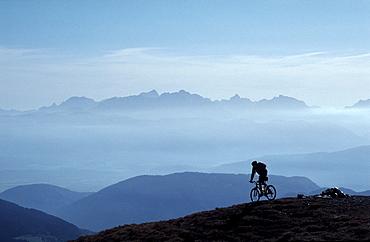 Mountain biker, Nock Mountains (Nockberge), Carinthia, Austria, Europe