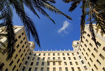 View of Hotel Nacional through palms in Havana, Cuba, Caribbean, Americas