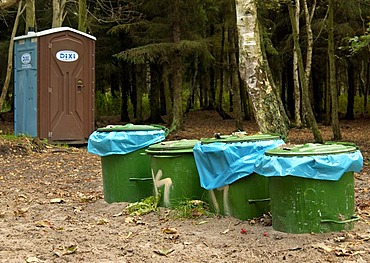 Green dust bins and transportable Dixi toilet in the forest of the National Park Vorpommersche Boddenlandschaft in Mecklenburg Vorpommern, Germany