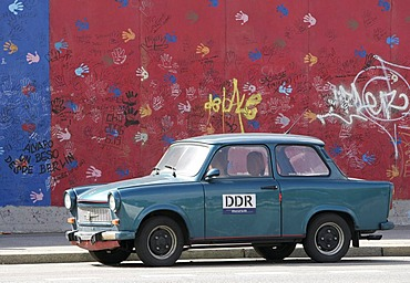 East German car (Trabi) in front of East Side Gallery in Berlin, Germany, Europe