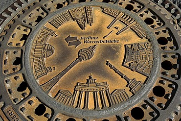 All Berlin sights on a rusty manhole cover, germany, Europe