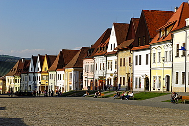 Historic town square of Bardejov surrounded by park benches and renovated old terraced buildings, UNESCO World Heritage Site,  Slovakia, Europe