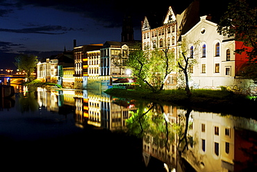 Facades, lit up, on the River Oder in Opole, Silesia, Poland, Europe