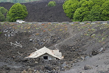 House covered in volcanic debris from Mt. Etna's last eruption, Sicily, Italy
